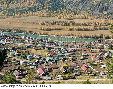 View From The Mountain To The Village Of Chemal And The Turquoise Katun River. Altai Republic, Russi