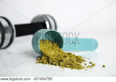 Measuring Scoop With Hemp Protein Powder On White Table