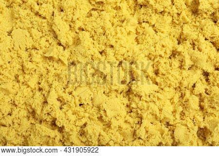 Yellow Kinetic Sand As Background, Closeup View