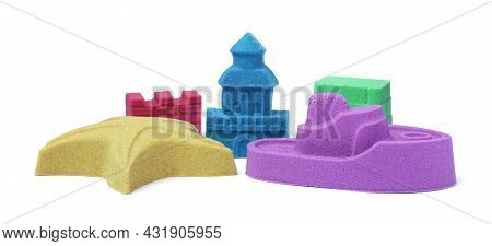 Different Figures Made Of Kinetic Sand On White Background