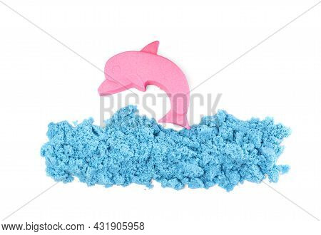Dolphin And Sea Made Of Kinetic Sand On White Background, Top View