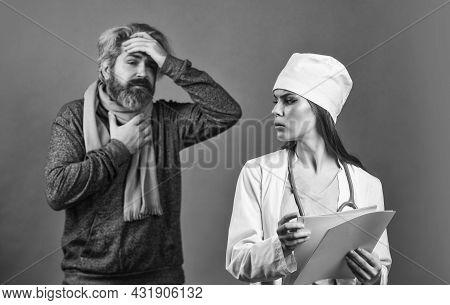 Nurse Visiting Unhealthy Man At Home. Cold Flu Symptoms. Virus Epidemic. Sick Patient. Doctor Patien