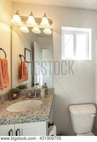 Vertical Bathroom Interior With Ambient Lighting And Window