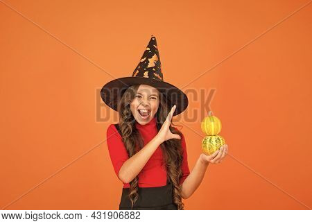 Halloween Shouting Child In Witch Hat Costume Making Spell With Pumpkin, Halloween Magic