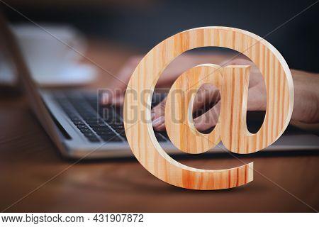 At Sign Illustration And Woman Sending Email Via Laptop At Table, Closeup