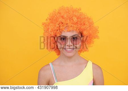 April Fools Day. Happy Childhood. Birthday Party. Funny Kid In Curly Clown Wig. Having Fun.