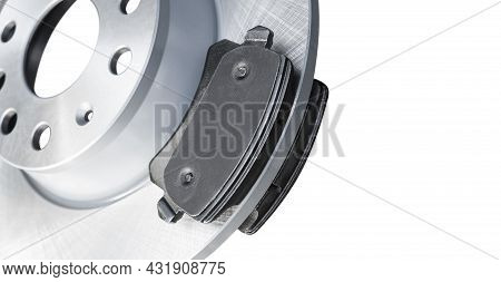 Brake Discs And Brake Pads Isolated On White Background. Auto Parts. Brake Disc Rotor Isolated On Wh