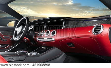 Red Luxury Modern Car Interior. Steering Wheel And Dashboard. Detail Of Modern Car Interior. Automat