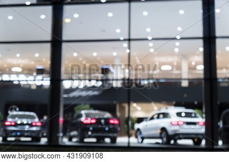 Blurred Background With Car Dealership Exterior. Abstract Blurred Photo Of Modern Building Motor Sho