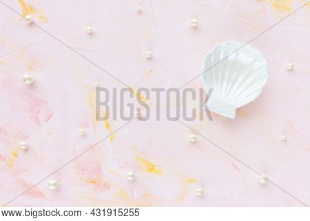 White Pearls And Ceramic Shimmering Seashell Decoration For Jewelry On Pink Creative Abstract Backgr
