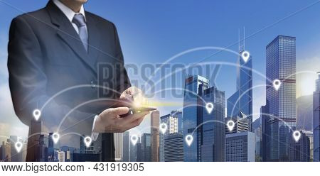 Businessman Use 5g Internet On Mobile Phone Find Location In City By Gps Navigator Map. Business Man