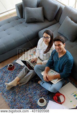 Mixed Race Family, Caucasian Husband And Asian Wife, Businesspeople Sitting And Working Together In