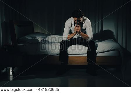 A Young Man In Casual Business Clothes Sitting Alone In Bedroom Holding A Pistol In A Thoughtful And