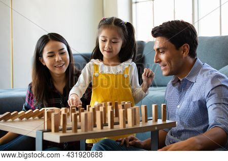 Mix Race Family Lovers, Caucasian Dad And Asian Mom With Half-blood Daughter Playing Wooden Domino G