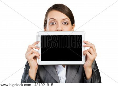 Businesswoman Holding Tablet Computer With Blank Screen. Beautiful Woman In Business Suit Show Table