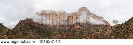 Panorama Of The Mountains Of Zion National Park In Utah With A Heavy Overcast And Clouds Dramaticall