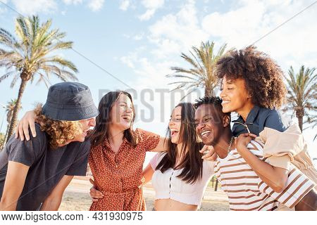 Group Of Young People Laughing And Having Fun Outside A Beach Town. Summer Concept, Multiethnic, Int