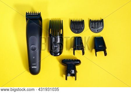 Tyumen, Russia - April 14, 2021: Braun Wet And Dry Electric Mens Shaver. On A Yellow Background