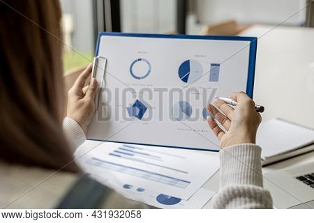 Businesswoman Checking Company Financial Documents, Financial Information Sheet Provided By Finance