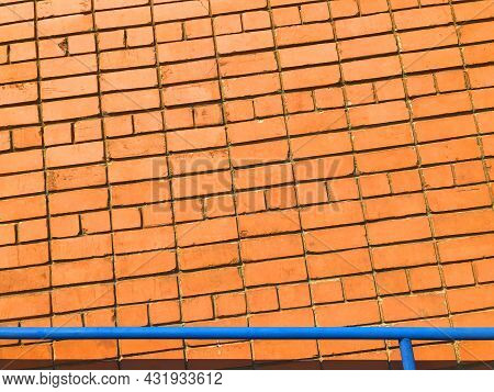 Orange Brick Wall. Textured Background With Copy Space For Design Work. Material Pattern. Reddish-br