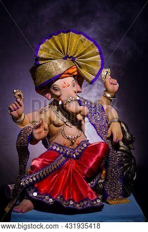 Lord Ganesha, Hindu God Ganesh On Black Background With A Smoke Of Incense