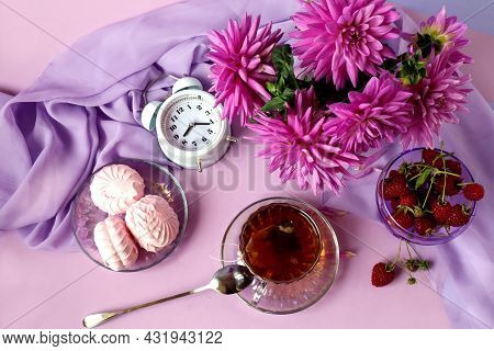 The Concept Of A Good Autumn Morning.a Cup Of Tea On A Saucer, A Bouquet Of Pastel Dahlias On A Ligh