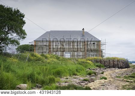 Derelict Council House In Poor Housing Area At Coastal Location