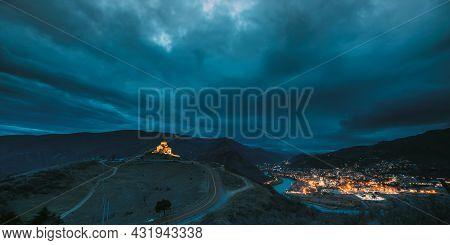 Mtskheta, Georgia. Ancient Jvari, Georgian Orthodox Monastery In Night Illuminations Lighting. World