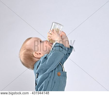 Little Toddler Toddler Eagerly Drinks Water From His Bottle, Drinking Everything Without A Trace. Cl