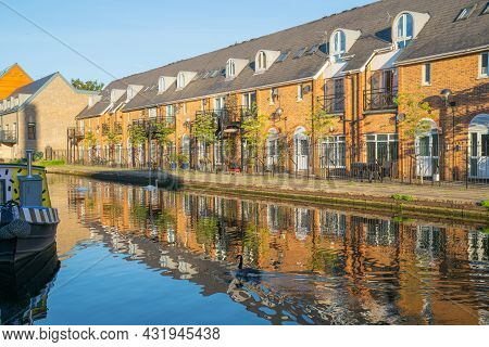 Canal-side Apartments Reflected In Calm Water In Morning Light In Bow Wharf Area Hertford Union Cana