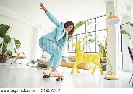Business Woman Riding Skateboard Dressed In Office Worker Outfit At Home. Office Worker Taking A Bre
