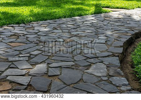 Grey Cobblestone At The Park Walkway.  Garden Footpath Made Of Grey Paving Stone