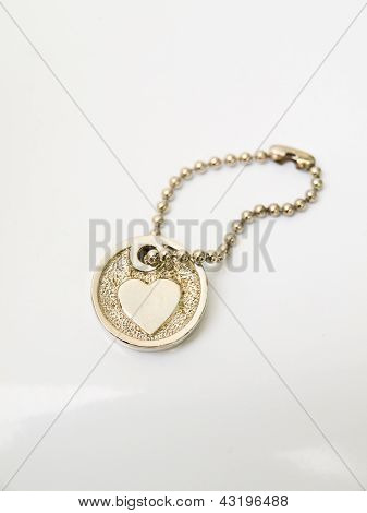 A Miniature Heart Keychain Isolated On White Background