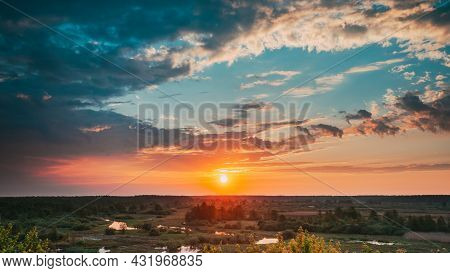 Beautiful Amazing Sunrise Above Summer Forest And River Landscape. Scenic View Of Morning Sky With R