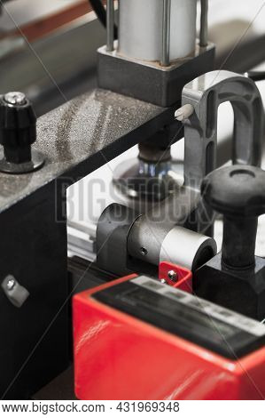 Workpiece Clamping Device On A Cnc Milling Machine, Close-up Abstract Industrial Photo With Selectiv