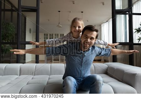 Happy Loving Daddy And Affectionate Daughter Girl Playing Airplane