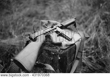 American Submachine Weapon Of World War Ii On Forest Stump. Black And White Toned Photo.