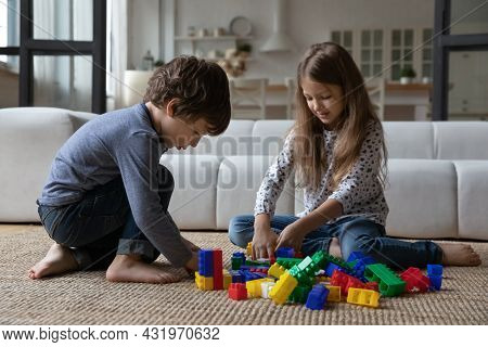Cute Sibling Kids Constructing Toy Tower, Completing Model