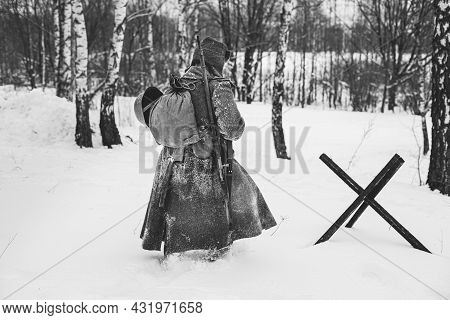 Re-enactor Dressed As World War Ii Russian Soviet Red Army Soldier Marching Through Snowy Winter For
