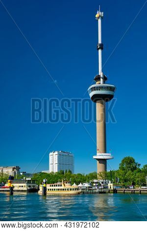 Rotterdam cityscape with Euromast observation tower and tourist boat on Nieuwe Maas river. Rotterdam, Netherlands