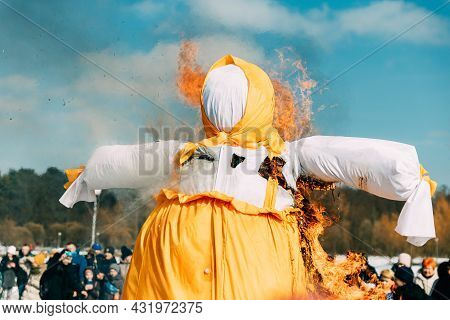 Burning Effigies Straw Maslenitsa In Fire On Traditional National Holiday Dedicated To Approach Of S