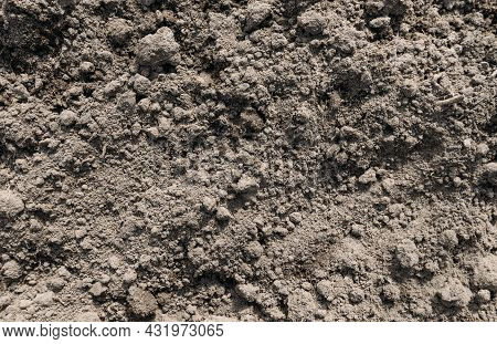 Black Dark Soil Dirt Background Texture, Natural Pattern. Flat Top View. Clods Of Earth.
