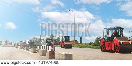 Repair Crews And Road Repair Equipment Moving On The Highway And Carry Out Asphalt Paving Works. Roa