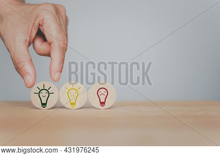 Human's Hand Choose Smiling Bright Light Bulb Icon On Circle Wood, For Good Idea, Best Selection, Be