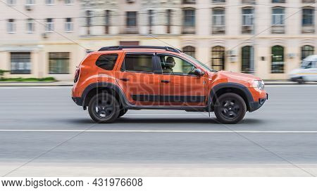 Dacia Duster Crossover Car Moving In The Street. Man Is Driving Fast Renault Duster On A City Road.