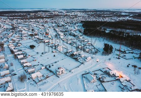 Aerial View Of Town Skyline Winter Evening Night. Snowy Landscape Cityscape Skyline.