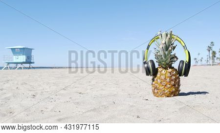 Funny Pineapple In Headphones, Sandy Ocean Beach By Blue Lifeguard Hut, California Usa, Pacific Coas