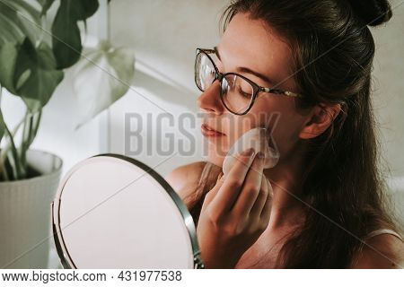 Young Woman With Long Hair In Eyeglasses Massaging Face With Gua Sha At Home. Massage For Sculpted C