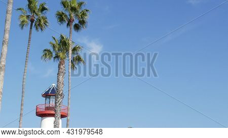 Retro Lighthouse, Tropical Palm Trees And Blue Sky. Red And White Vintage Old-fashioned Beacon. Wate