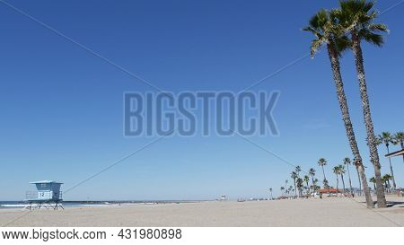 Tropical Palm Trees On White Sandy Beach By Sea Water Waves, Pacific Ocean Coast, Oceanside Californ